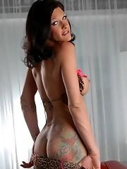 Morgan posing her massive cock in hot pink stockings