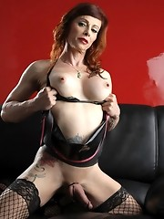 Seductive Jasmine posing in hot latex and fishnets