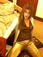 Kirsty has a sexy gold outfit on and she is giving a naughty webcam show to a lucky fan.