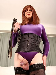 Mistress Lucimay is ready with her crop to deal out a little bit of TGirl punishment.