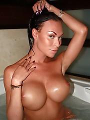 Transsexual pornstar Mia posing in a jacuzzi
