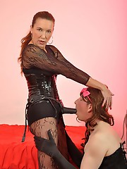Strapon Jane fucks a TGirls mouth and teases her caged gimp.