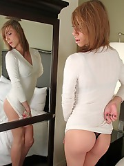 Cute tgirl Chloe Rose stripping on the bed