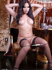 Brunette beauty Holly strips and plays