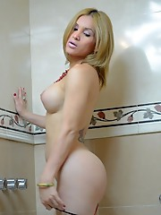 Lovely Naty poses and masturbates