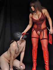 Mistress Carly uses her electro strapon cock to show her submissive what happens when he is a naughty boy.