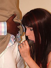 Horny TGirl gets her hands on a monster black cock and sucks it.