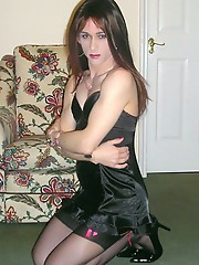 Hot TGirl Kirsty is wearing a tight black sexy number and playing with her hard cock