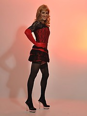 Gorgeous blonde tranny posing in a sexy nylon basque and lovely stockings