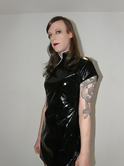 Crossdresser wearing slutty black pvc dress gets a very red ass from a hard spanking