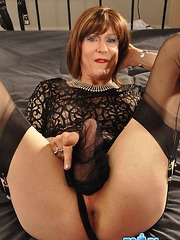 Horny TGirl Emily wraps her big erect cock in nylon for a naughty wank