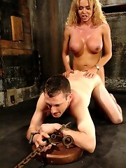TS Gia Darling chains up and ass fucks the elevator repair man.