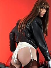 This sexy crossdresser looks fantastic on her Ducati