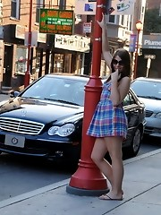 Seductive transsexual teasing on the street in public