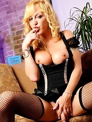 Hot transsexual Olivia Love posing in sexy black net stockings