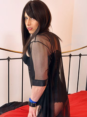 A beautiful crossdressing slut in sexy black lingerie plays with her big cock and fucks ass with dildo toy