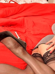 Hot TGirl Dannii teases her gorgeous ass and cock in sexy black panties, nylon stockings and high heels