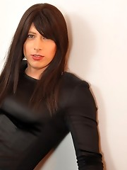 Gorgeous crossdresser with long black hair posing