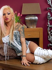A Petite Tranny with tattoos and blonde hair to her ass