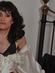Beautiful naughty crossdresser wearing a long white wedding dress and horny satin gloves